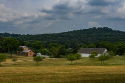 The Bushman Farm on a Stormy Day with Big Round Top and Little Round Top in the Distance