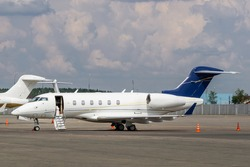 The business jet with the open airstairs waiting for the passangers