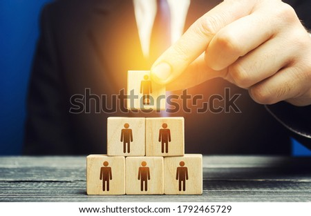 The business leader establishes the structure of the company. Recruiting and appointing employees for suitable posts, creation effective business model. Personnel management. Meritocracy and autonomy. Stock photo ©