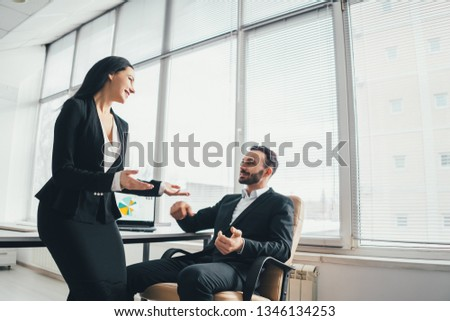 The business man and a woman discussing near the office table
