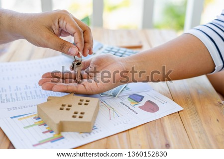 The business of borrowing money to buy a house with financial documents and tax inspections from a consultant when checking through will make an agreement and contract buy a home.