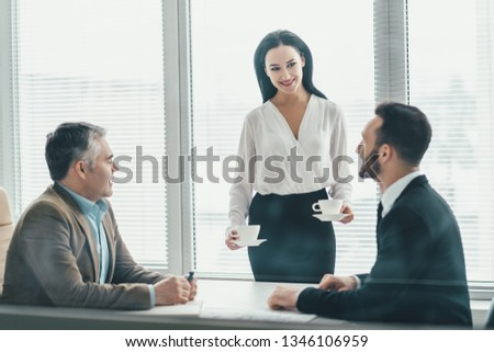 The business people sitting at the office table #1346106959