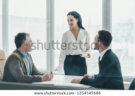 The business people sitting at the office table #1354549688