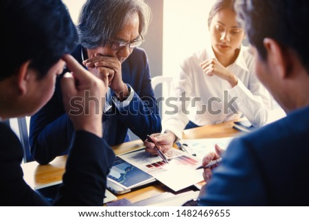 The business team is meeting with stress due to operating losses and the economic downturn. Stock photo ©