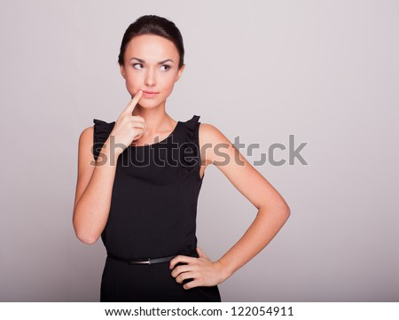 the business woman in a black dress reflected