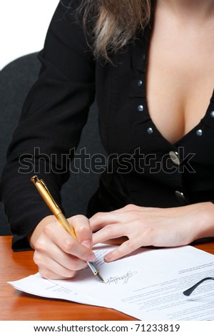The business woman signs the contract.Photo closeup. It is isolated on the white background.