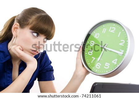 The business woman with clock in hands. It is isolated on a white background