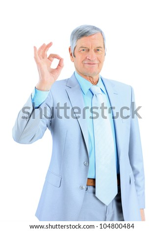 The businessman at the age shows that everything is OK. Isolated on a white background.