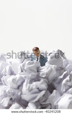 The businessman buried in the form trash.