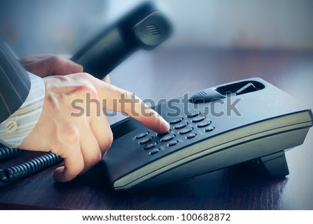 The businessman calling by phone.