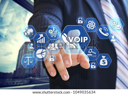 The businessman chooses VOIP on the virtual screen in social network connection.  #1049035634
