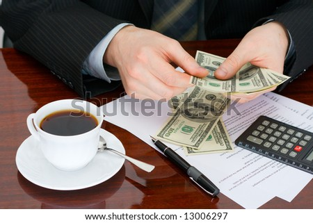 The businessman considering at office of money