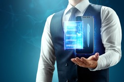 The businessman has a blue hologram of the contract in the palm of his hand. Concept of electronic document circulation, electronic signature, online cooperation. Mixed environment