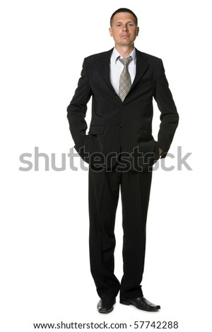 The businessman in a black suit. It is isolated on a white background
