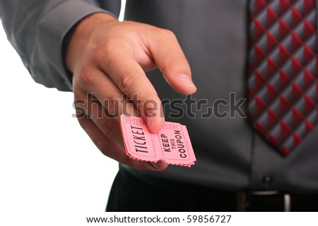 The businessman in a grey shirt and a tie stretches the ticket with the coupon.