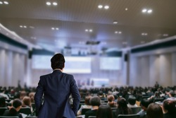 The Businessman in the auditorium.