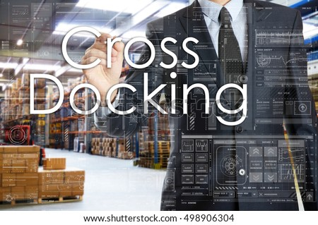 the businessman is writing things connected with the logistics in warehouse. Cross Docking