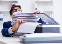 The businessman making copies in copying machine