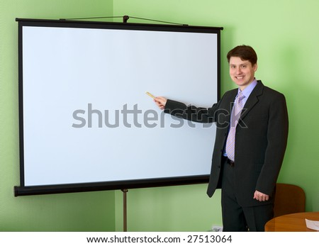 The businessman standing near the white screen - stock photo