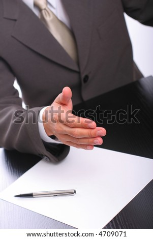 The businessman stretches a hand for handshake