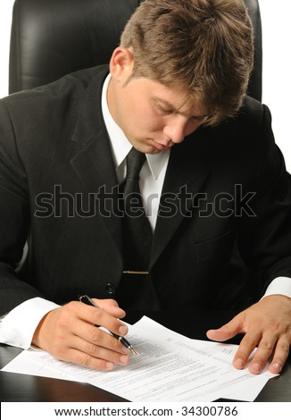The businessman the studying contract before the signature