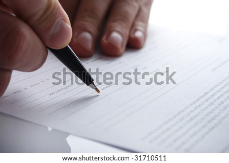 The businessman undersigning - stock photo