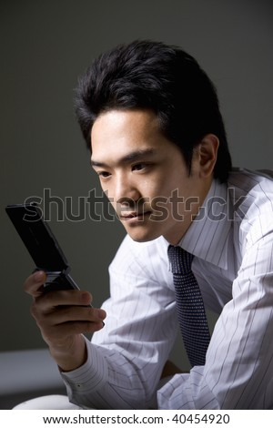 The businessman who operates a cellular phone.