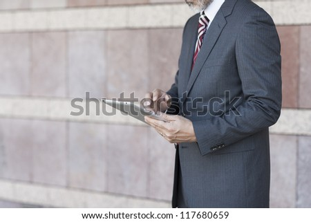 The businessman who operates a tablet PC