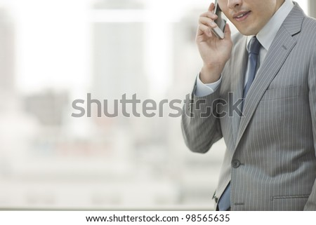 The businessman who talks on the telephone