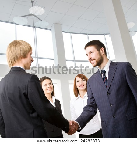 The businessmen welcoming each other at office