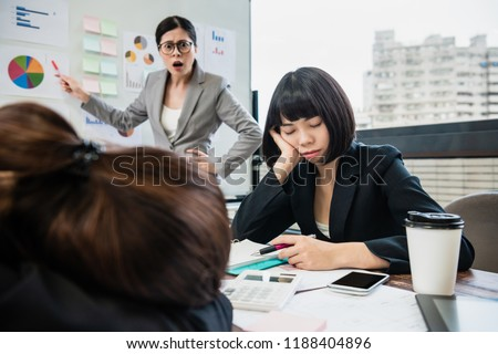 the businesswoman is yelling at her colleagues who doze off in the meeting.