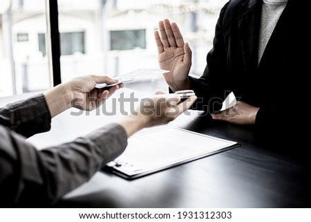 The businesswoman raised her hand to deny this conscience, she did not sign and accept money for participating in the upcoming large-scale corruption scheme, bribing was illegal and immoral. Stock photo ©