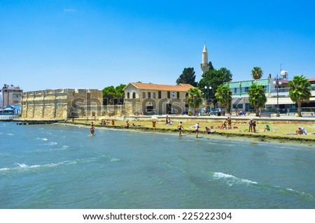 The busy Finikoudes beach next to the old castle in the city centre, Larnaca, Cyprus.