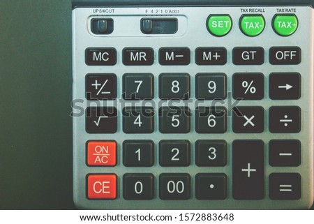 The button for calculating numbers is used in various calculations.