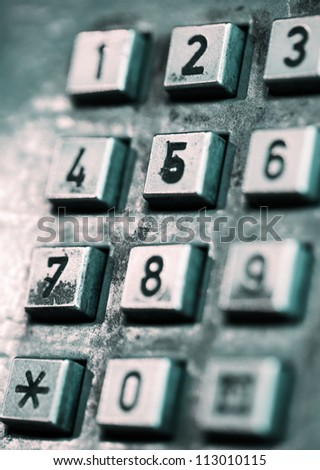 The buttons of an old-style street public telephone. Shallow depth of field.