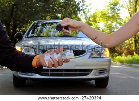 The buyer transfers money for the new car