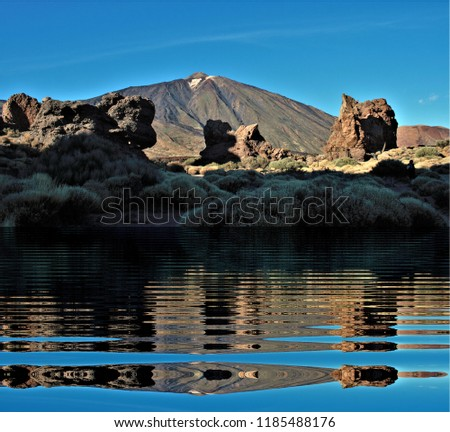 The Cañadas del Teide reflected in the water, Tenerife,tourism, tourist, advertising, tourist destination, holidays, travel, travelers, happiness, relaxation, fun, #1185488176