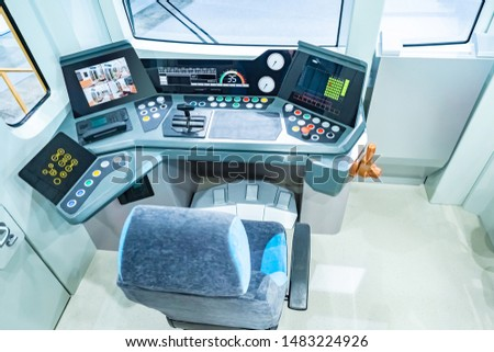 The cabin of the electric train. Driver place of the electric train. Dashboard. The control cabin of the electric train. Railway suburban transport. Passenger transport. Suburban transport network. #1483224926