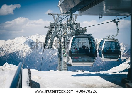 Shutterstock The cable car up to Rosa Khutor, Sochi, Russia. There are cabins of funicular with passengers inside.