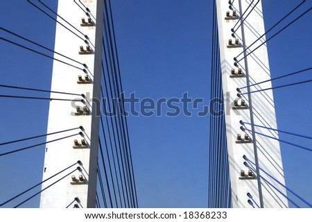 The cable stayed bridge supporting columns and suspension cable under the blue sky.