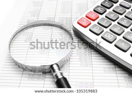 The calculator, magnifier on documents.
