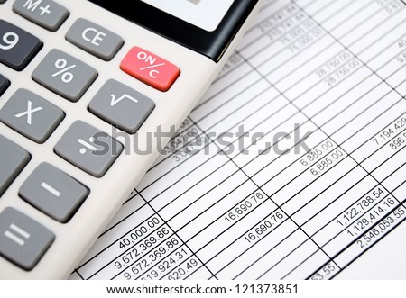 The calculator on documents. Accounts department.