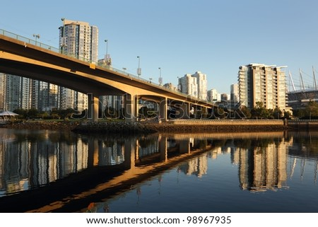 The Cambie Bridge, at sunrise, crosses False Creek into downtown Vancouver. British Columbia, Canada.