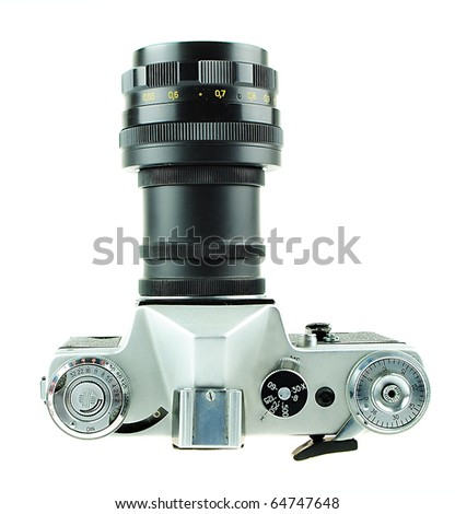 The camera in style of a retro is isolated on a white background