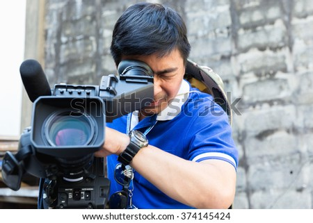The cameraman filming outdoor event #374145424