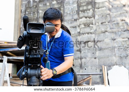 The cameraman filming outdoor event #378696064