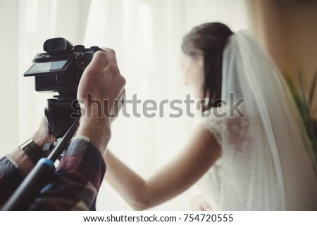 the cameraman takes off the wedding #754720555