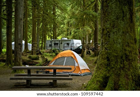 The Campground Small Orange Tent And Travel Trailer In