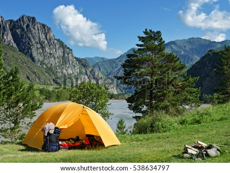 The Camping Tent near mountain river in the summer