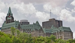 The canadian Parliament Confederation Building facing the Ottawa river in Ottawa, Canada.